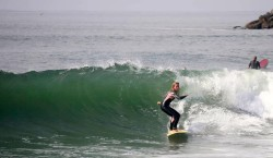 Two Paths: Having escaped a life of abuse to begin living the abundant life that Jesus promised his followers, Jennifer Faith surfing in southern California